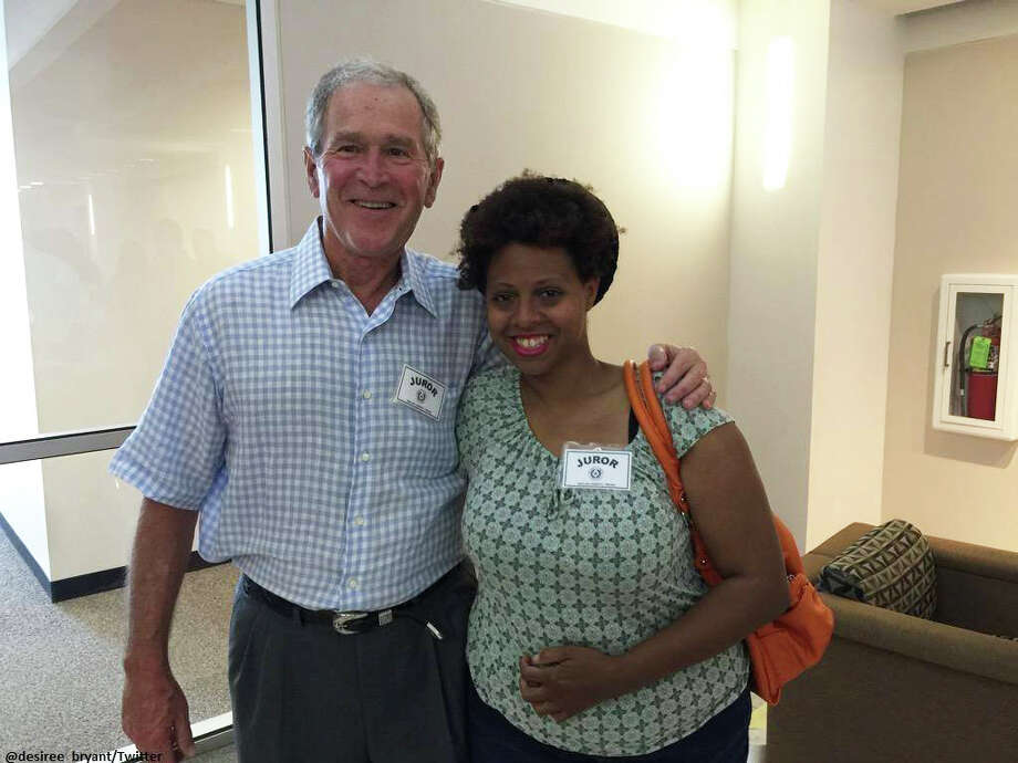 Former President George W. Bush and Desiree Bryant report for jury duty Wednesday in Dallas. / handout