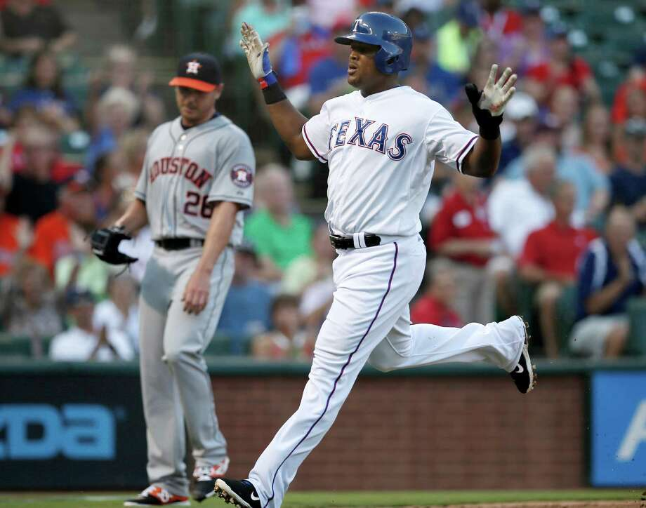 Texas Rangers' Adrian Beltre celebrates after crossing the plate, scoring on a Elvis Andrus single off of Houston Astros' Scott Kazmir, rear, in the first inning of a baseball game, Wednesday Aug. 5, 2015, in Arlington, Texas. (AP Photo/Tony Gutierrez) Photo: Tony Gutierrez, STF / AP