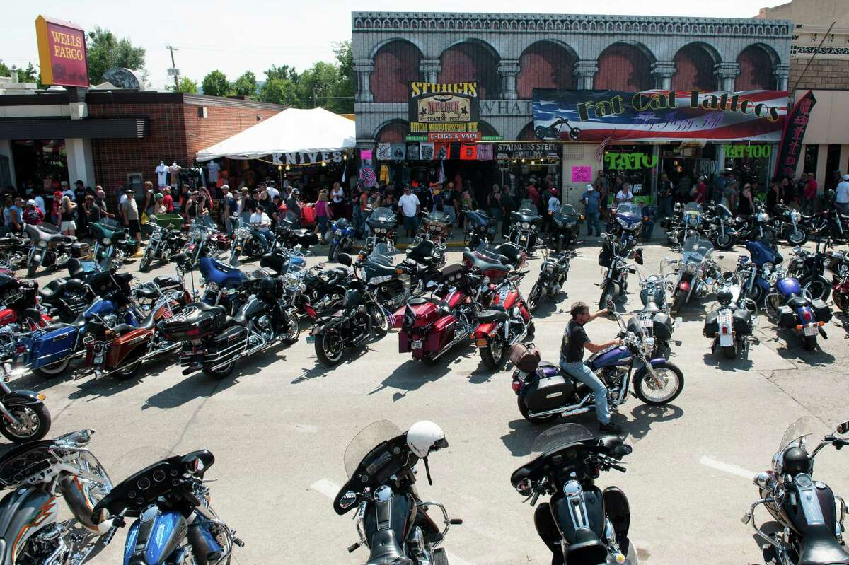 STURGIS, SD - AUGUST 3: A biker rides downtown on the first day of the annual Sturgis Motorcycle Rally August 3, 2015 in Sturgis, South Dakota. This year marks the seventy-fifth anniversary of the rally, with crowds of up to 1.2 million people are expected.