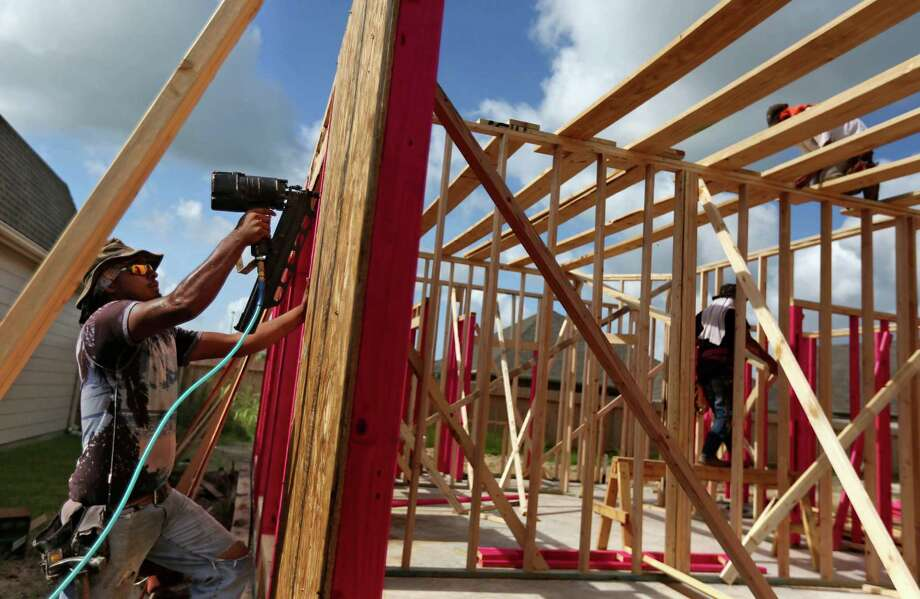 A home under construction has already been sold along the 6500 block of Granbury Rd. in the Lakeland housing plan currently under construction Friday, July 17, 2015, in Manvel. Manvel is preparing for the anticipated growth by setting up its road plan, parks plan and other preparations. Photo: Gary Coronado, Houston Chronicle / © 2015 Houston Chronicle