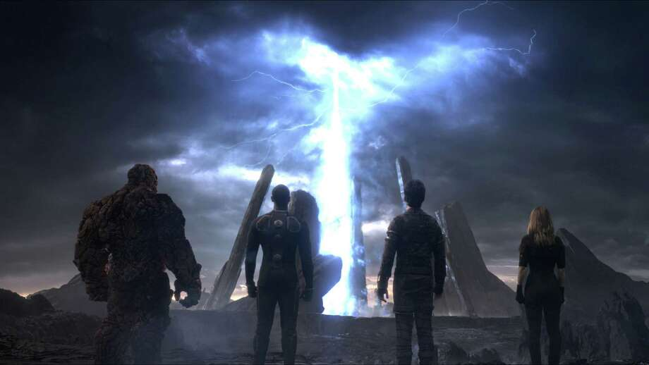 "This photo provided by courtesy Twentieth Century Fox shows, The Thing, from left, Michael B. Jordan as Johnny Storm, Miles Teller as Dr. Reed Richards, and Kate Mara as Sue Storm, in a scene from the film, ""Fantastic Four,"" releasing in U.S. theaters on Aug. 7, 2015. (Twentieth Century Fox via AP) Photo: Courtesy Twentieth Century Fox, HONS / Associated Press / Twentieth Century Fox"