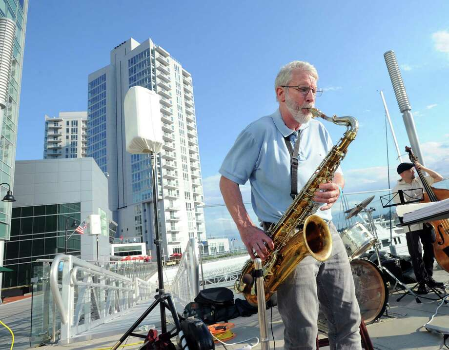 Saxaphone player Al Brooks does a solo that was part of the Barbara Occhino's Serenade performance during the New Neighborhoods Inc. summertime fundraiser, Jazz on the Rocks, at Harbor Point in Stamford on Wednesday, Aug 5, 2015. Proceeds from the event benefited New Neighborhoods, a nonprofit developer of affordable rental and ownership housing for families, seniors, veterans and others. Photo: Bob Luckey Jr. / Hearst Connecticut Media / Greenwich Time