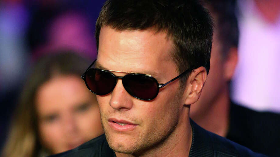 Because quarterback Tom Brady is married to a supermodel and seems to  lead the ideal life, he is all over the tabloids. Photo: Mark J. Rebilas / Mark J. Rebilas