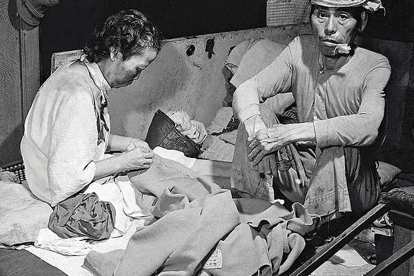 Blast victims shown in a fly-infested makeshift hospital in a bank building in Hiroshima. 15th September, 1945. The atomic bomb Little Boy, was dropped on Hiroshima by an American B-29 bomber, the Enola Gay, flown by Colonel Paul Tibbets, directly killing an estimated 80,000 people. By the end of the year, injury and radiation brought the total number of deaths to 90,000-166,000. Hiroshima, Japan.