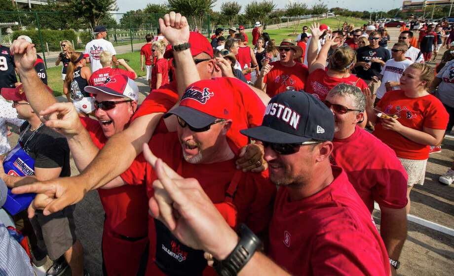 Battle Red Wagon team members cheer as they are named the winners of the Tailgater of the Game - Training Camp Edition. Photo: Brett Coomer, Staff / © 2015 Houston Chronicle
