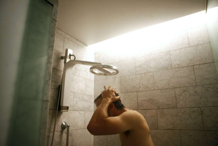 Nebia, a San Francisco startup, is looking to change the way we shower with its revolutionary shower-head that saves more than 70 percent of the water used by your typical shower.  Co-Founder and CEO, Philip Winter, demonstrated how the product worked for media on Wednesday, Aug. 5, 2015. Photo: Cameron Robert, The Chronicle