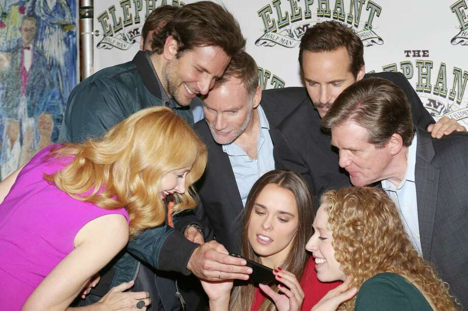 (From left) Patricia Clarkson, Bradley Cooper, Peter Bradbury, Emma Thorne,  Alessandro Nivola, Anthony Heald and Amanda Lea Mason attend the 'The Elephant Man' Broadway cast photo call at Sardi's on October 21, 2014 in New York City. Photo: Walter McBride, Getty Images / 2014 Walter McBride