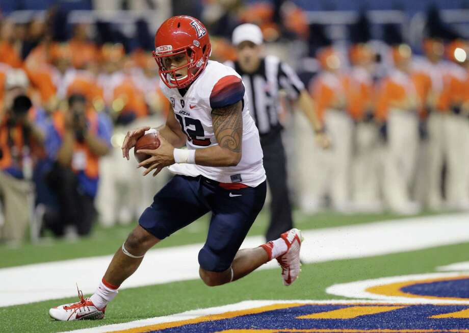 Arizona's Anu Solomon scrambles with a bobbled snap in the end zone during the first half of an NCAA college football game against UTSA, Thursday, Sept. 4, 2014, in San Antonio. Arizona received a safety on the play. Photo: Eric Gay /Associated Press / AP