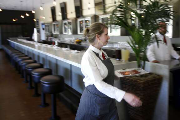 Server Katie Jackson works at the Presidio Social Club in San Francisco, Calif., Monday, July 9, 2012.  Since the Presidio Social Club is located on federal land, they are exempt from California's new law banning foie gras. They have announced that they will begin serving the delicacy beginning Saturday, July 14.