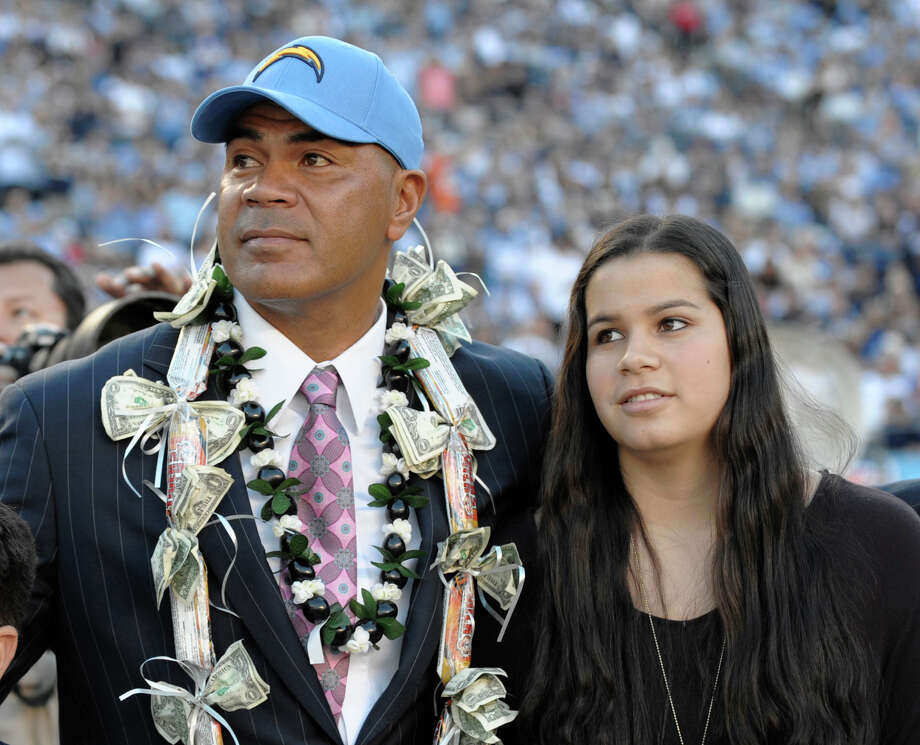 Sydney Seau, with her father in 2011, will not be speaking at her father's induction into the the Pro Football Hall of Fame during the Aug. 8 ceremony. Photo: Denis Poroy, Associated Press / FR59680 AP
