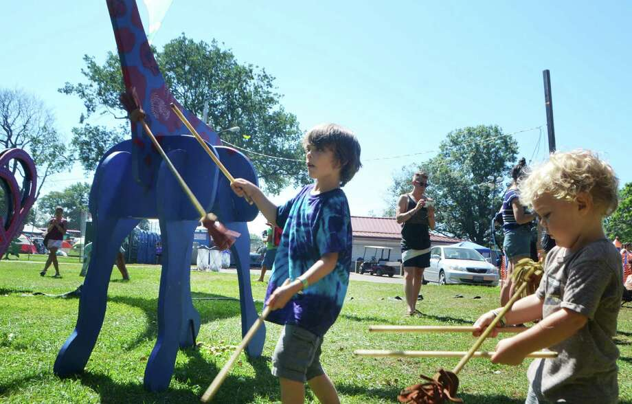 Six-year-old Odin and his two-year-old brother, Joshua Duko of Delaware, play double sticks on the last day of 20th Annual Gathering of the Vibes on Sunday, August 2, 2015. Photo: Bailey Wright, For Hearst Connecticut Media / Connecticut Post Freelance