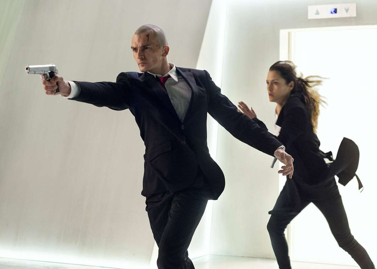 RUNNING RUNNING AS FAST AS THEY CAN ... do you think they'll make it? Agent 47 (Rupert Friend) and Katia (Hannah Ware) move it, move it in