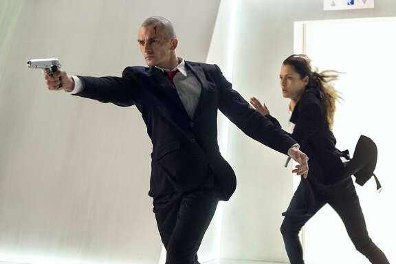 "RUNNING RUNNING AS FAST AS THEY CAN ... do you think they'll make it? Agent 47 (Rupert Friend) and Katia (Hannah Ware) move it, move it in ""Hitman: Agent 47,"" a remake/reboot of 2007's ""Hitman."" Whether it is the first movie based on an actual video game to be actually good remains to be seen. Movie opens August 21. Photo credit: Reiner Bajo. Courtesy Twentieth Century Fox Film Corporation. DF-04496_04515_R -- Agent 47 (Rupert Friend) and Katia (Hannah Ware) are on the run in ""Hitman: Agent 47."""