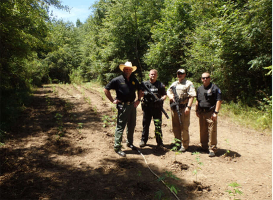 Newton County Sgeriff Eddie Shannon, Deputy A. Brunette, Game Warden L. Spacek and Newton Police Officer j. Christmas courtesy photo