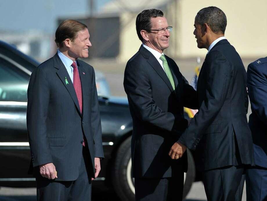 U.S. Sen. Richard Blumenthal watches as Gov. Dannel P. Malloy greets President Barack Obama in 2013 Photo: MANDEL NGAN / Mandel Ngan /AFP /Getty Images / 2013 AFP  MANDEL NGAN/AFP/Getty Images