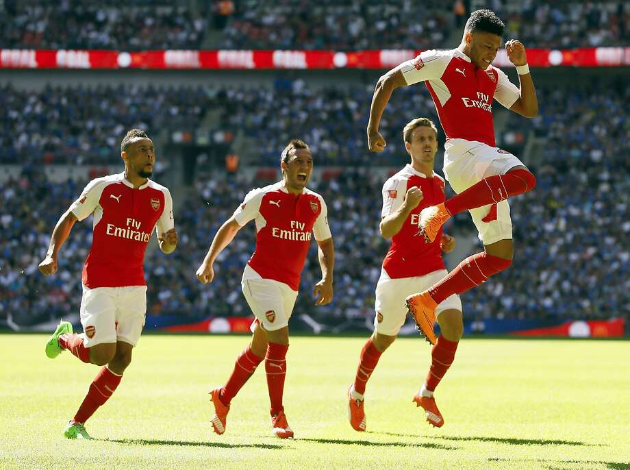The new Premier League season has some, including Arsenal's Alex Oxlade-Chamberlain, jumping for joy. Photo: Kirsty Wigglesworth, Associated Press