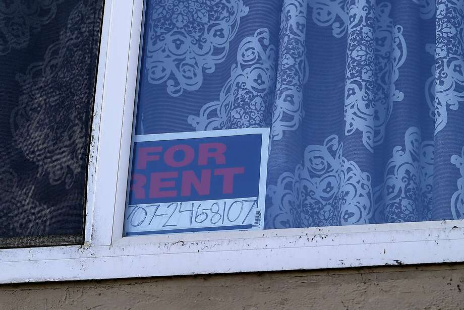 The sign hangs in the window for an apartment for rent in Richmond, Calif. Photo: Brant Ward, The Chronicle