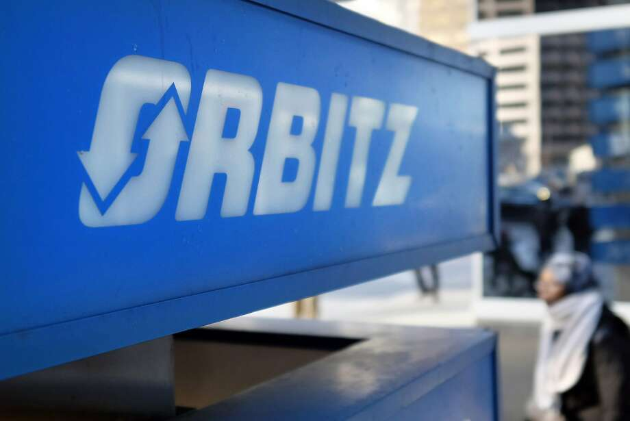 Chicago's Orbitz is close to a deal with Expedia. Left: Expedia analytics team workers chat in an alcove set up for employees in Bellevue, Wash. Photo: Kiichiro Sato, Associated Press