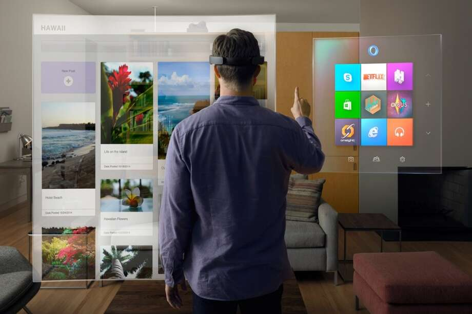 HoloLens overlays digital graphics over real-world objects, so you'll be able to see what's going on around you while also viewing content displayed by the headset. Photo: Microsoft
