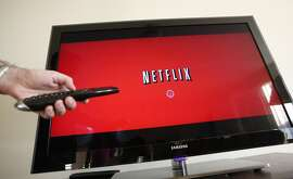 FILE - In this July 20, 2010 file photo, a person uses Netflix in Palo Alto, Calif. Netflix on Tuesday, Aug. 4, 2015 said it will expand into Japan beginning Sept. 2, 2015 to give the Internet video service its first presence in Asia. (AP Photo/Paul Sakuma, File)