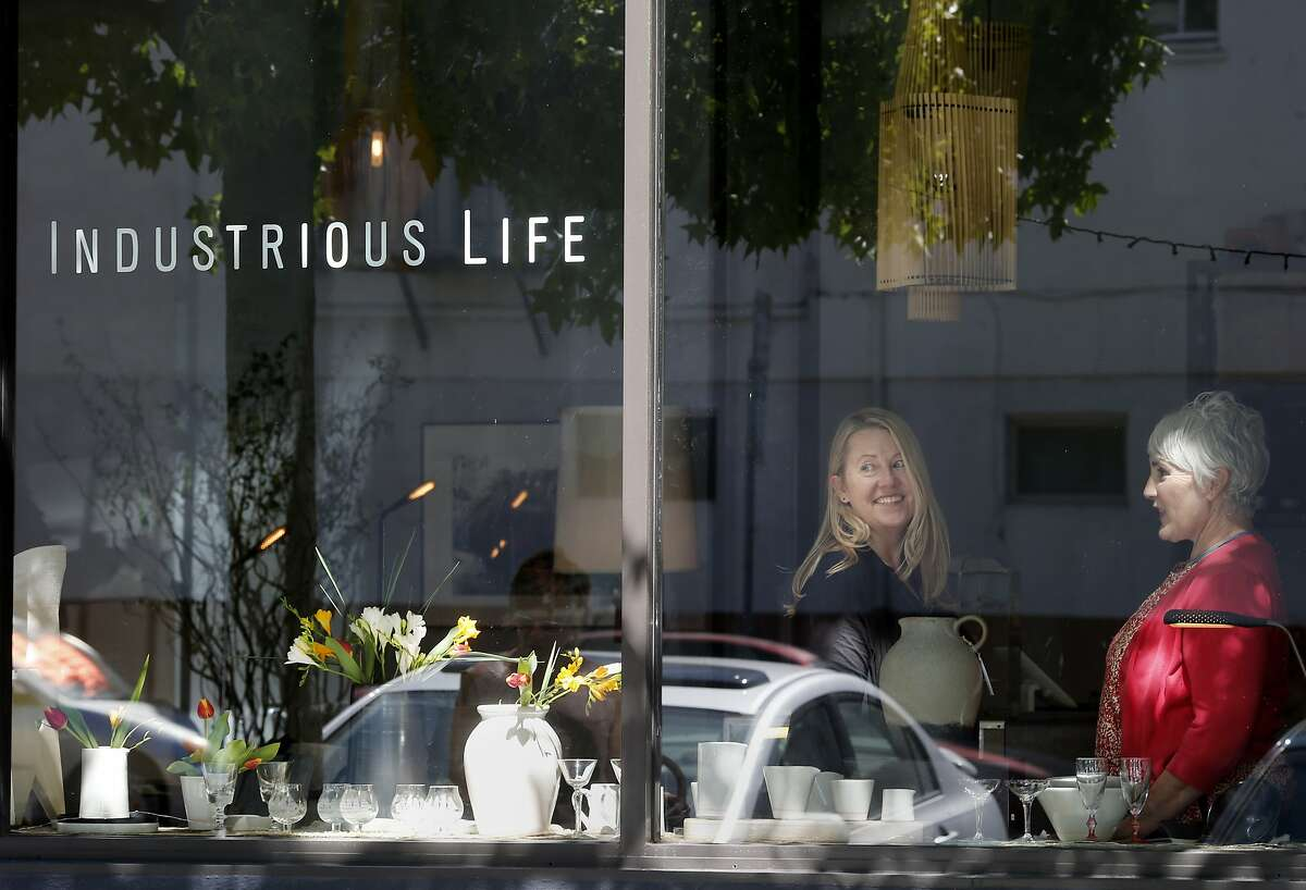 Industrious Life owner Patti Davidson (left) and college Patti Quill pause in the store on Tennessee Street in San Francisco, Calif. New Dogpatch district shop called Industrious Life with quality modern home furnishings and design.