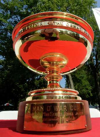 The Man o' War trophy which will be presented to the winner of the Travers Stakes in on display in the paddock of the Saratoga Race Course Aug 21, 2013 in Saratoga Springs, N.Y. during the post position draw in which  Verrazano was named the morning line favorite to win the Travers Stakes which will run on Saturday at Saratoga.  (Skip Dickstein/Times Union) Photo: SKIP DICKSTEIN, ALBANY TIMES UNION