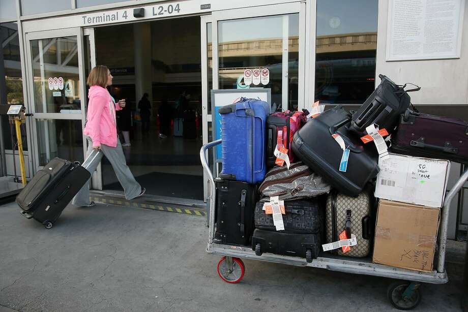 A Senate report is urging the Transportation Department to crack down on unfair or hidden airline fees for seat choices, checked bags and ticket changes. Photo: Nick Ut, Associated Press