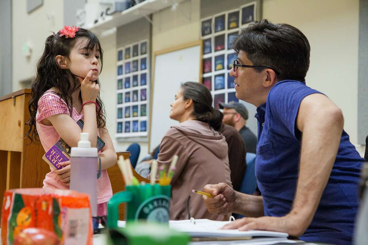 Savvy Crawford, left, who plays Young Amélie in 'Amélie' and Daniel Messé chat during rehearsals at the Berkeley Repertory Theatre, Wednesday, Aug. 5, 2015, in Berkeley, Calif. The theatre is producing the new musical with score and lyrics by Messé.