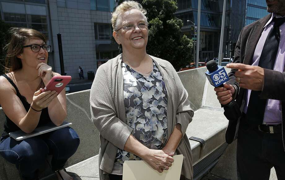 Uber driver Sara Knapp (middle) answers questions during a press conference at the plaza entrance of 450 Golden Gate Ave.  in San Francisco, Calif., on Thursday, August 6, 2015.  Drivers discuss the O'Conner vs. Uber lawsuit seeking to reclassify Uber drivers in California as employees.  Knapp became an Uber driver New Years day this year. Photo: Liz Hafalia, The Chronicle
