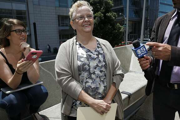 Uber driver Sara Knapp (middle) answers questions during a press conference at the plaza entrance of 450 Golden Gate Ave.  in San Francisco, Calif., on Thursday, August 6, 2015.  Drivers discuss the O'Conner vs. Uber lawsuit seeking to reclassify Uber drivers in California as employees.  Knapp became an Uber driver New Years day this year.