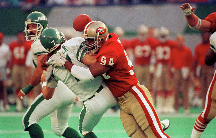 Charles Haley finished his career with 100.5 sacks. Here he adds Jets' quarterback Ken O'Brien to the list in a 1989 game in East Rutherford, N.J. Photo: Bill Kostroun / Bill Kostroun / Associated Press (1989) / AP