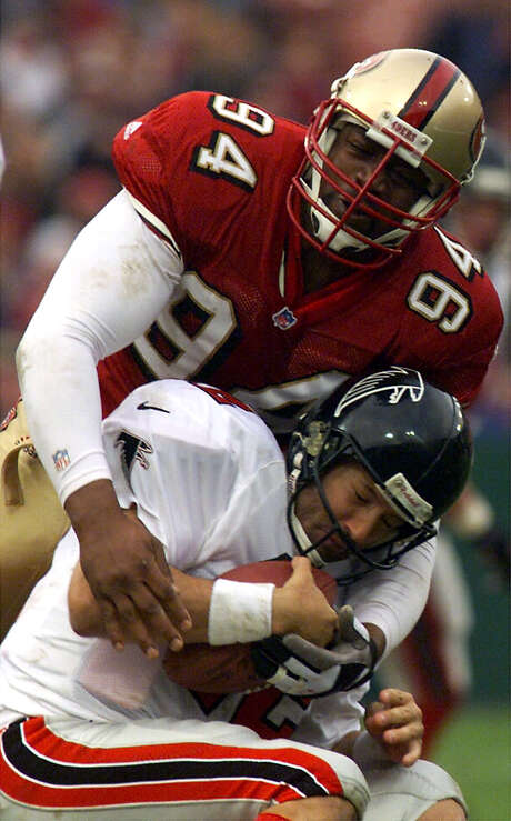 The last sack of Charles Haley's career: Atlanta quarterback Chris Chandler is taken down in a December 1999 game at then-named 3Com Park at Candlestick Point. Photo: FREDERIC LARSON / Frederic Larson / The Chronicle (1999) / SAN FRANCISCO CHRONICLE