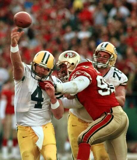 Charles Haley, here putting pressure on Green Bay quarterback Brett Favre in a 1999 wild card playoff game, is still the 49ers' all-time record holder with seven postseason sacks. Photo: BOB GALBRAITH / Bob Galbraith / Associated Press (1999) / AP