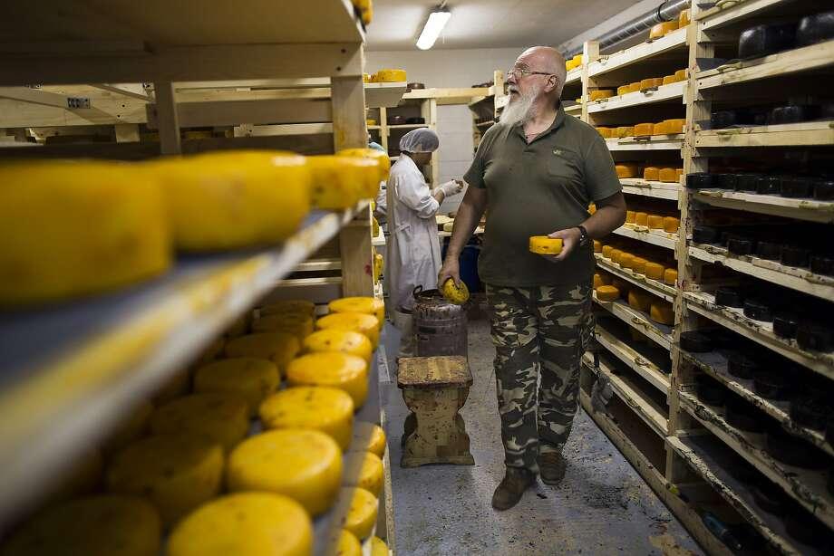 John Kopiski, who farms in the Vladimir region, backs the ban. He hopes to expand production to fill the market niche. Photo: Alexander Zemlianichenko, Associated Press