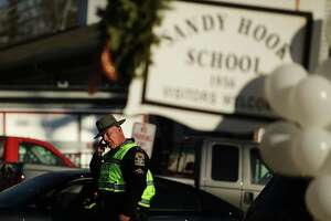 Connecticut state police will release a second report December 27, 2013 concluding their investigation of the Dec. 14, 2012 Newtown school shooting that left 20 children and six women dead inside Sandy Hook Elementary School. NEWTOWN, CT - DECEMBER 15: A police officer stands outside of the entrance to the Sandy Hook School on December 15, 2012 in Newtown, Connecticut. Twenty six people were shot dead, including twenty children, after a gunman identified as Adam Lanza opened fire at Sandy Hook Elementary School. Lanza also reportedly had committed suicide at the scene. A 28th person, believed to be Nancy Lanza was found dead in a house in town, was also believed to have been shot by Adam Lanza. (Photo by Spencer Platt/Getty Images)