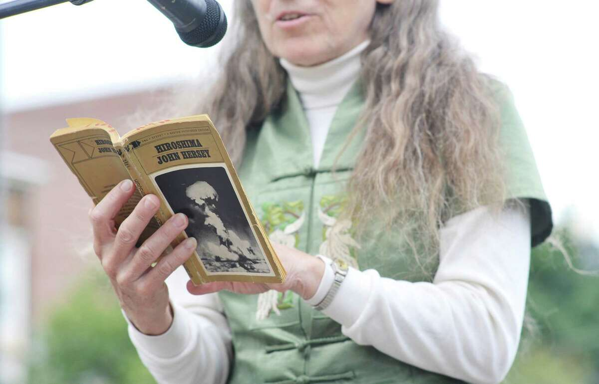 "Dinah Farrington reads from John Hersey?'s ?""Hiroshima?"" on Thursday, Aug. 6, 2015, in Townsend Park in Albany, N.Y. (Paul Buckowski / Times Union)"