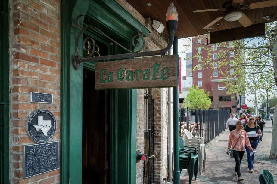People walk by La Carafe, Friday, March 21, 2014, in Houston. Photo: Michael Paulsen, File  / © 2014 Houston Chronicle
