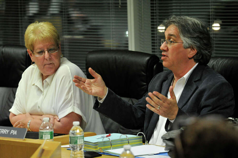 Board of Education member Jerry Pia, right, pictured with board President Jackie Heftman, has yet to resign his seat, though he said he would last month. Photo: Jason Rearick / Jason Rearick / Stamford Advocate