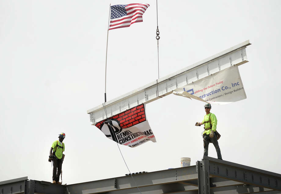 The final beam is lowered in to place during the topping off ceremony for the new Longfellow School in Bridgeport, Conn. on Thursday, August 6, 2015. Photo: Brian A. Pounds / Hearst Connecticut Media / Connecticut Post