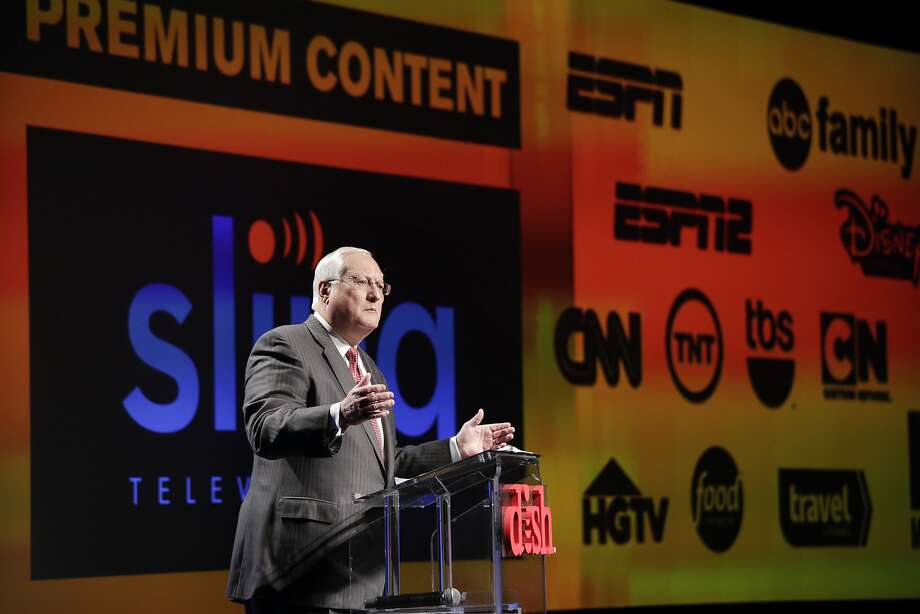 FILE- In this Jan. 5, 2015 file photo, Joe Clayton, president and CEO of Dish Network, introduces the Sling TV, a live television streaming service, at a news conference at the International CES in Las Vegas. Dish said its satellite TV subscriber losses accelerated in the quarter through June, falling 81,000 to 13.9 million, nearly double the loss of 44,000 a year ago. Analysts say that popular channels like ESPN would likely survive any dramatic shift in consumer preference toward online channel packages like Sling TV, which at $20 a month, is far cheaper than traditional pay TV packages. (AP Photo/Jae C. Hong, File) Photo: Jae C. Hong, Associated Press