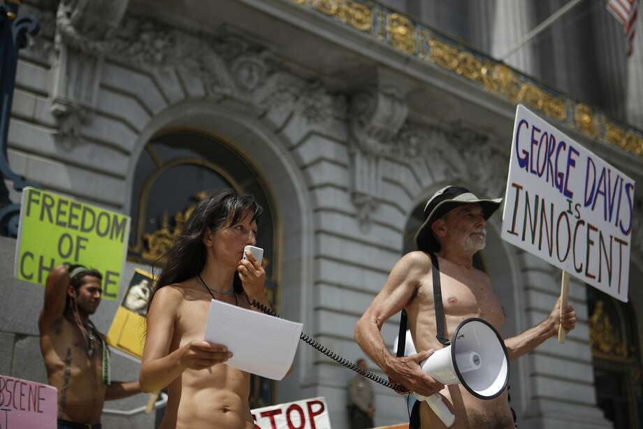 Gypsy Taub (middle) speaks while George Davis (right) and James (right) listen and support nudism at City Hall in San Francisco, California, on Thursday, August 6, 2015. Photo: Brandon Chew, The Chronicle