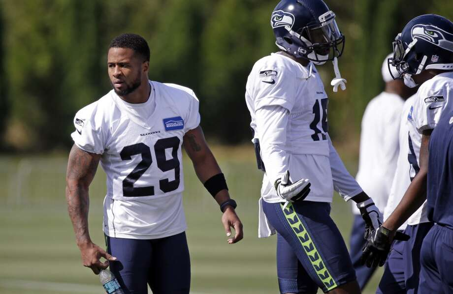 Seattle Seahawks' Earl Thomas (29) stands on the sidelines after being removed from the Physically Unable to Perform list at an NFL football training camp Thursday, Aug. 6, 2015, in Renton, Wash. Thomas has been recovering from an off season shoulder surgery. (AP Photo/Elaine Thompson) Photo: AP