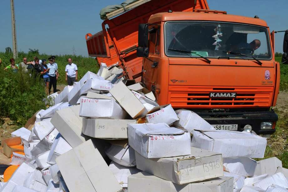"A handout photo released by the Russians food safety agency shows a truck dumping boxes of cheese outside the Russian city of Belgorod on Thursday. 2015. Russian officials on August 6 steamrollered tonnes of cheese as they began a  controversial drive to destroy Western food smuggled into the crisis-hit country despite a public outcry. President Vladimir Putin last week signed a decree ordering the trashing of all food -- from gourmet cheeses to fruit and vegetables -- that breaches a year-old embargo on Western imports imposed in retaliation to sanctions over the Ukraine crisis. AFP PHOTO / ROSSELKHOZNADZOR BELGOROD    -- RESTRICTED TO EDITORIAL USE - MANDATORY CREDIT "" AFP PHOTO / ROSSELKHOZNADZOR BELGOROD "" - NO MARKETING NO ADVERTISING CAMPAIGNS - DISTRIBUTED AS A SERVICE TO CLIENTS ---/AFP/Getty Images Photo: -, Handout / AFP"