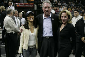 Eva Longoria, Peter Holt and his wife Julianna take in the Spurs-Mavericks game at the SBC Center on Nov. 24, 2004.