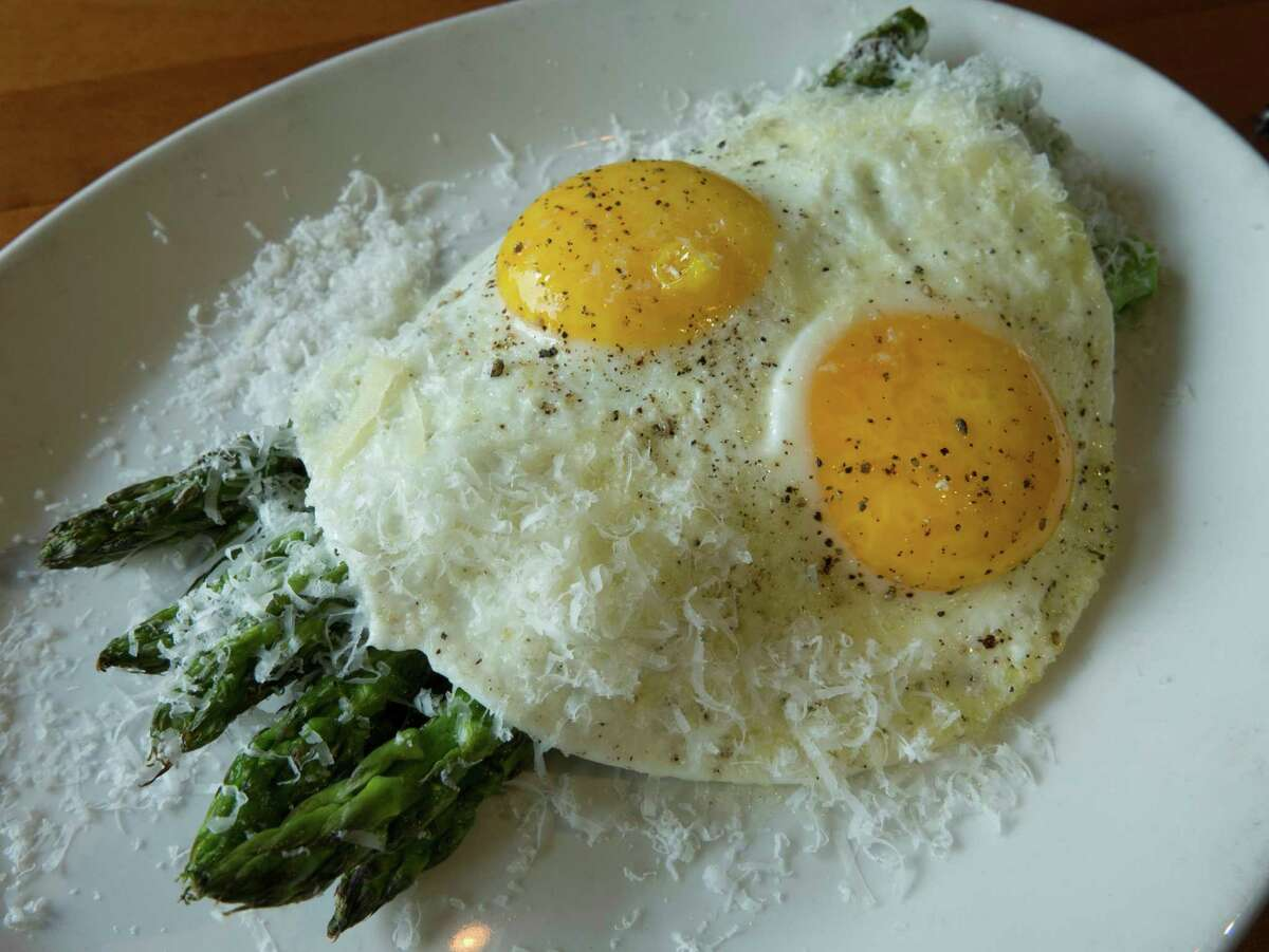 Pierce the yolks of the beautifully poached eggs and let them run over the grilled asparagus for a simply elegant sauce in the asparagus Milanese.