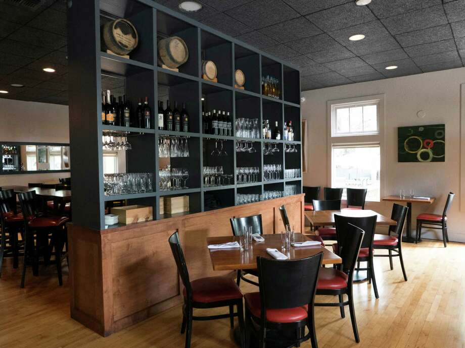 The stylish and sophisticated interior design complements the menu from executive chef-owner Jason Dady and chef de cuisine Margeaux Alcorta. Photo: Billy Calzada /San Antonio Express-News / San Antonio Express-News