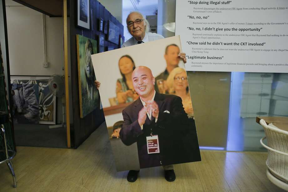 """Attorney J. Tony Serra,  representing Raymond Chow, shows off a giant image of """"Shrimp Boy"""" in his office. Photo: Mike Kepka"""