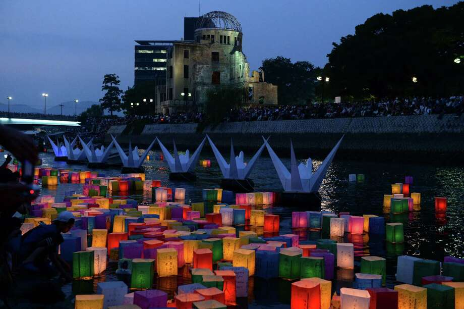 Paper lanterns float on the Motoyasu river near the Atomic Bomb Dome after being released on Thursday, Aug. 6, 2015, to grieve over victims of the atomic bombing in Hiroshima, Japan. Hiroshima, the city destroyed by a U.S. atomic bomb in 1945 during World War II, commemorated the 70th anniversary of the bombing Thursday at the city's Peace Memorial Park, with its mayor calling for peace and elimination of nuclear weapons. (Ma Ping/Xinhua/Zuma Press/TNS) Photo: Ma Ping, MBR / McClatchy-Tribune News Service / Zuma Press