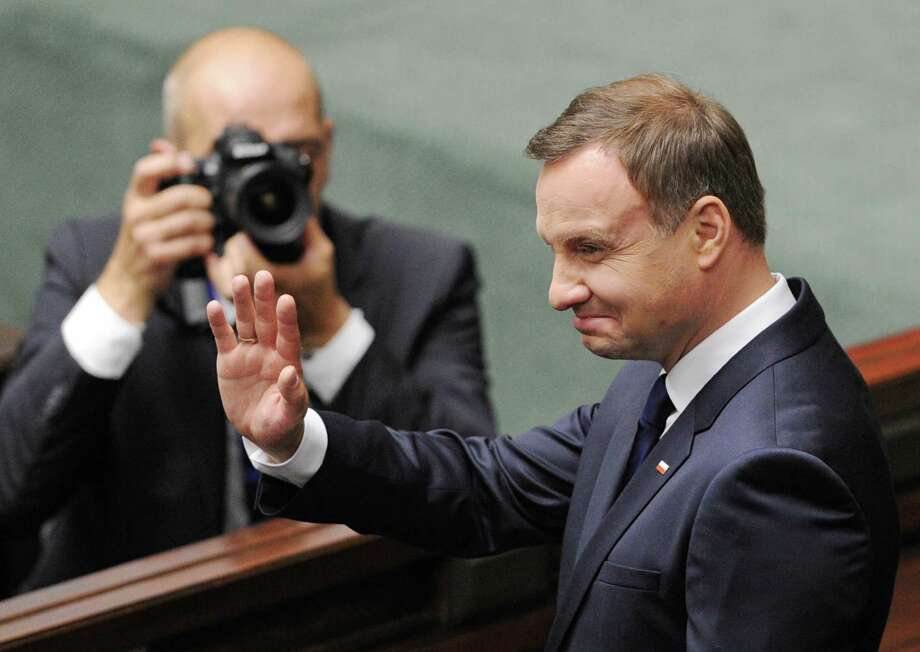 Poland's new, conservative President Andrzej Duda greets the National Assembly after he officially took office in a swearing-in ceremony at the Parliament in Warsaw, Poland, Thursday, Aug.  6, 2015.   (AP Photo/Alik Keplicz) Photo: Alik Keplicz, STR / AP