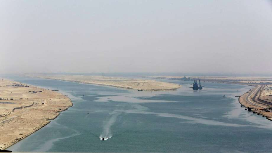 An army zodiac secures the entrance of the new section of the Suez Canal in Ismailia, Egypt, Thursday, Aug. 6, 2015. Egypt on Thursday will unveil a major extension of the Suez Canal that President Abdel-Fattah el-Sissi has billed as an historic achievement needed to boost the country's ailing economy after years of unrest. (AP Photo/Amr Nabil) Photo: Amr Nabil, STF / Associated Press / AP